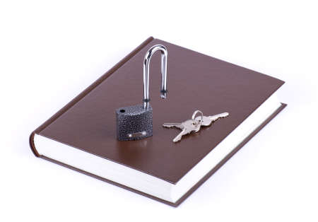 The brown book, key and padlock isolated Stock Photo - 11759730