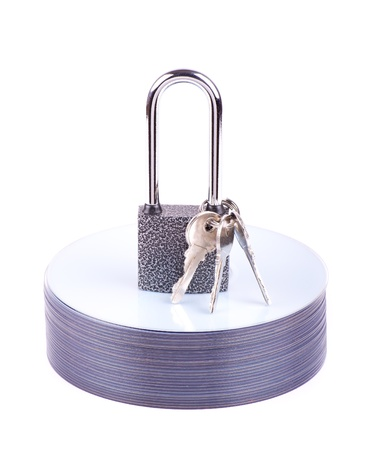 Padlock and key on the stack of CD isolated photo