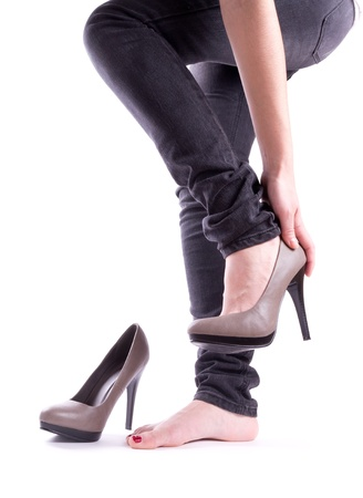 the sole of the shoe: The woman took off her shoes isolated Stock Photo