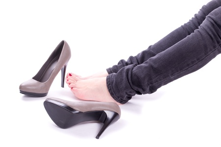 Woman relaxing near her shoes isolated photo