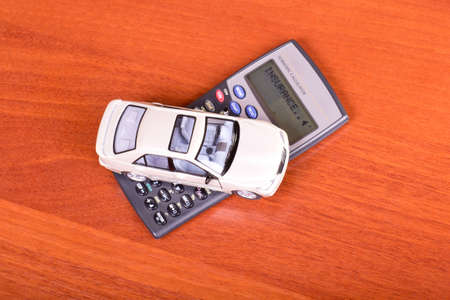 Model car on a calculator on the table photo