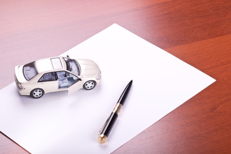 Model of the car and pen on paper Stock Photo