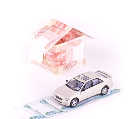Model car in the house of banknotes isolated Stock Photo - 11770990
