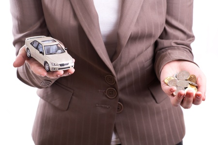 Woman holding the model of car and coins Stock Photo