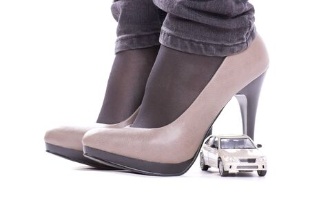 Model of the car about shoes isolated photo