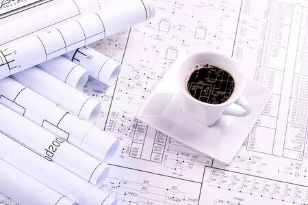 Cup of coffee and detail drawing photo