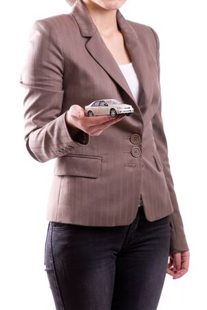 Woman's hand holding the model of car Stock Photo - 12075402