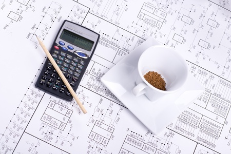 Calculator, pancil, cup of coffee and detail drawing photo
