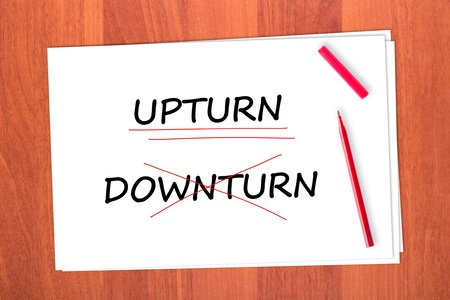 downturn: Chose the word UPTURN, crossed out the word DOWNTURN