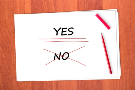 strikethrough: Chose the word YES, crossed out the word NO Stock Photo
