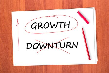 chose: Chose the word GROWTH, crossed out the word DOWNTURN
