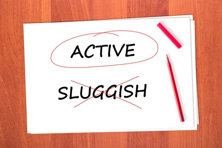 strikethrough: Chose the word ACTIVE, crossed out the word SLUGGISH Stock Photo