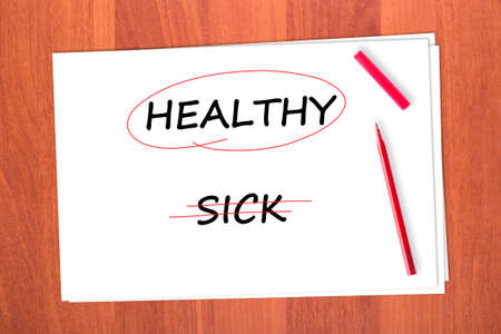 chose: Chose the word HEALTHY, crossed out the word SICK Stock Photo