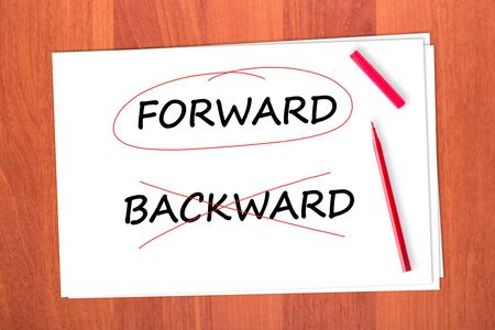 Chose the word FORWARD, crossed out the word BACKWARD Stock Photo - 12343246