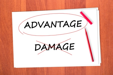 strikethrough: Chose the word ADVANTAGE, crossed out the word DAMAGE Stock Photo