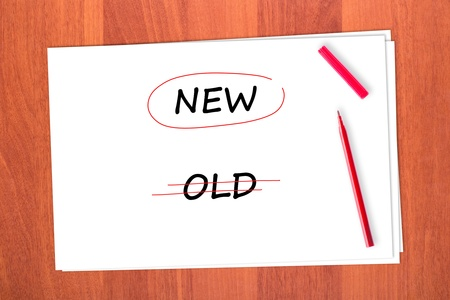 chose: Chose the word NEW, crossed out the word OLD Stock Photo