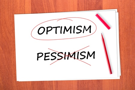 pessimism: Chose the word OPTIMISM, crossed out the word PESSIMISM Stock Photo