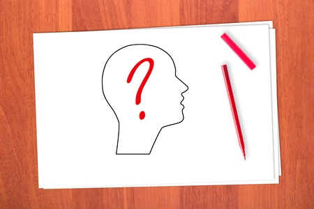Drawing head and question mark on table photo