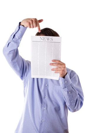 Man reading a newspaper with inscription NEWS Stock Photo