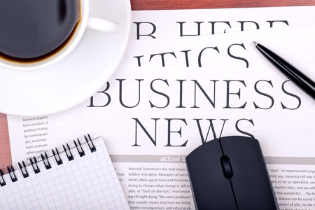 Several newspapers and cup of coffee on table Stock Photo - 12779995