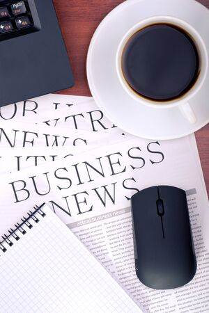 Several newspapers and cup of coffee on table Stock Photo - 12780004