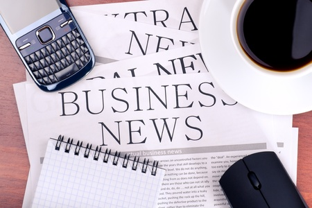 Several newspapers and cup of coffee on table Stock Photo - 12780003