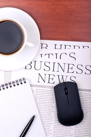 Several newspapers and cup of coffee on table Stock Photo - 12780122