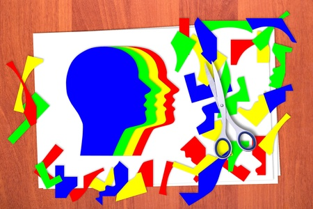 Four multicolored head and scrap on table Standard-Bild