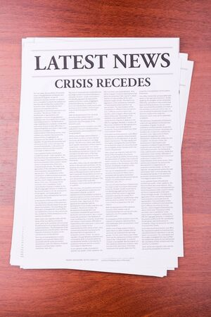 recedes: The newspaper LATEST NEWS with the headline CRISIS RECEDES