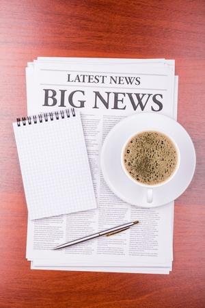 The newspaper LATEST NEWSwith the headline BIG NEWS  and coffee Stock Photo - 13200124