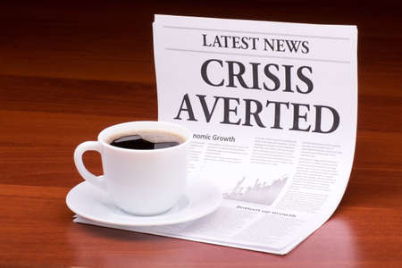 The newspaper LATEST NEWSwith the headline CRISIS AVERTED on table Stock Photo - 13199897