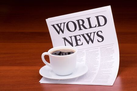 The newspaper LATEST NEWSwith the headline WORLD NEWS on table Stock Photo - 13200002