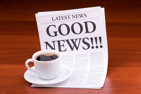 The newspaper LATEST NEWSwith the headline GOOD NEWS    on table Stock Photo