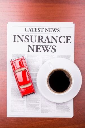 The newspaper LATEST NEWSwith the headline  INSURANCE NEWS and auto photo