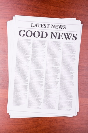 The newspaper LATEST NEWS with the headline GOOD NEWS Stock Photo