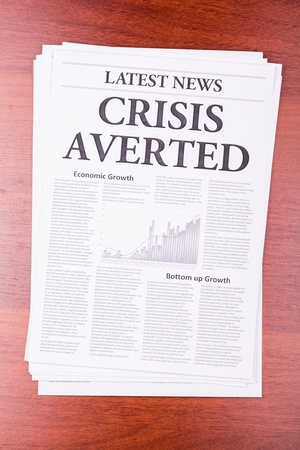 The newspaper LATEST NEWS with the headline CRISIS AVERTED