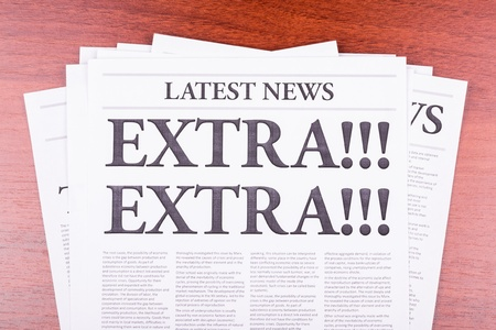 The newspaper LATEST NEWS with the headline EXTRA! EXTRA! Stock Photo