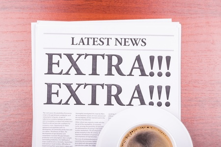 The newspaper LATEST NEWS with the headline EXTRA! EXTRA!  and coffee