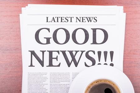 The newspaper LATEST NEWSwith the headline GOOD NEWS  and coffee Stock Photo - 13303629