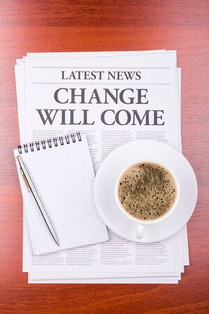 The newspaper LATEST NEWS with the headline CHANGE WILL COME  and coffee photo