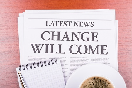 The newspaper LATEST NEWSwith the headline CHANGE WILL COME  and coffee Stock Photo - 13303631