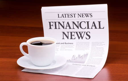 The newspaper LATEST NEWSwith the headline  FINANCIAL NEWS on table Stock Photo - 13303574