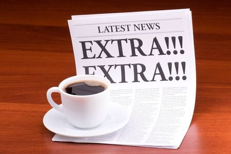 The newspaper LATEST NEWSwith the headline EXTRA! EXTRA! on table Stock Photo - 13303582