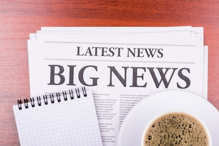 The newspaper LATEST NEWS with the headline BIG NEWS  and coffee Stock Photo
