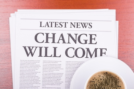 The newspaper LATEST NEWSwith the headline CHANGE WILL COME  and coffee Stock Photo - 13624637