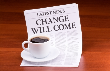 The newspaper LATEST NEWS with the headline CHANGE WILL COME on table Stock Photo