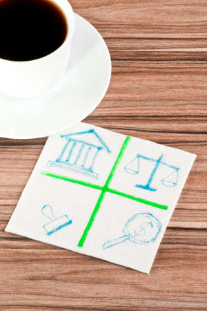 Emblem of the law on a napkin and cup of coffee Stock Photo - 14488587