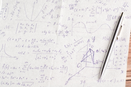 Mathematical calculations on a napkin and cup of coffee