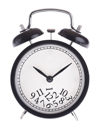Alarm clock with a bunch of numbers on the dial isolated
