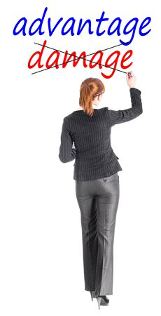 Girl in a business suit writing the word Stock Photo - 17801316